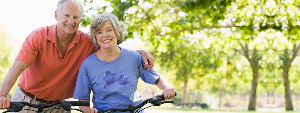 Happy Senior Couple On Bikes