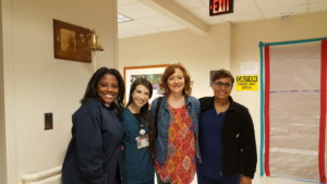Rachael with all of her nurses on her last day of radiation