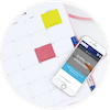 circular icon with phone sitting on top of a planner