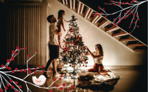Family decorating a Christmas tree in their home